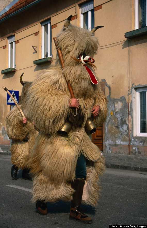 Close up of one of the 'Kurents', representing a god, dressed in sheepskins, cow bells around the waist and a mask, these characters go from house to house to banish evil spirits during the Kurentovanje festival in February.