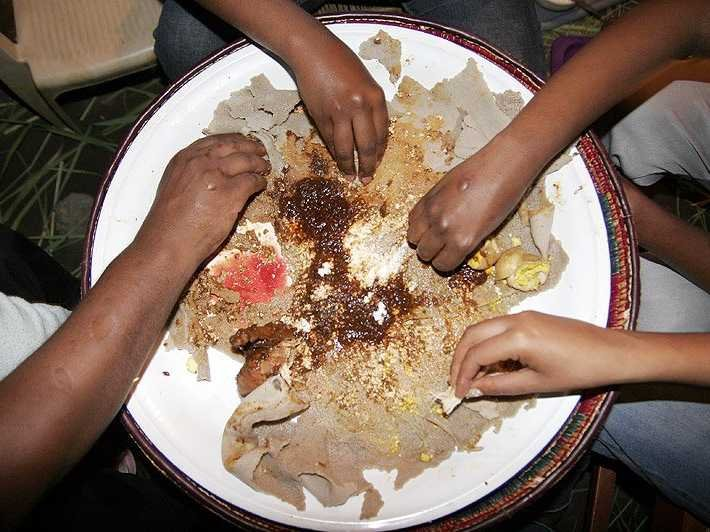 in-ethiopia-locals-eat-a-doro-wat-a-chicken-stew-served-with-flat-bread-forget-the-forks-and-knives-because-like-much-ethiopian-cuisine-you-eat-this-with-your-hands